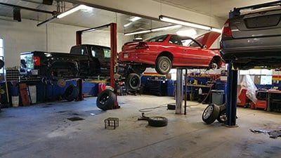 image of a car being serviced - auto repair service in Bedford PA