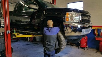 Image of one of our ASE mechanics working on a car - auto repair in bedford PA