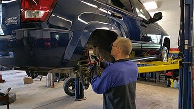 Image of an ASE certified mechanic fixing brakes - Auto Repair Service in Bedford PA