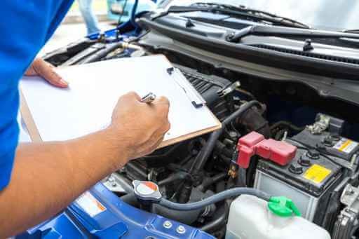Picture of a man holding a clipboard - Auto Repair service in Bedford PA